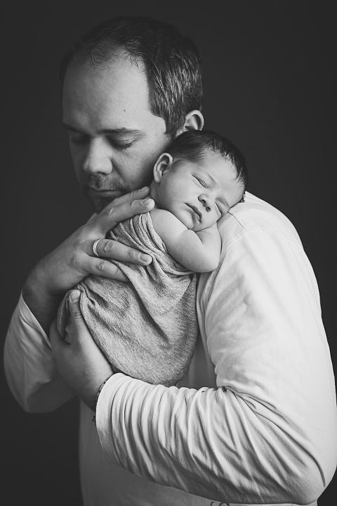 Fotoshooting Baby mit Familienfotos